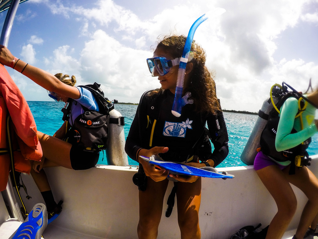 Preparing for a boat dive off of Cape Eleuthera, with underwater slate in hand to take notes while observing the coral reef.