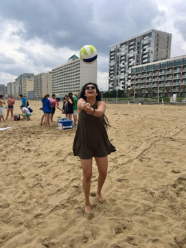 Nina Cervantes hitting a volleyball